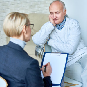 female consultant doing counseling to her old man client